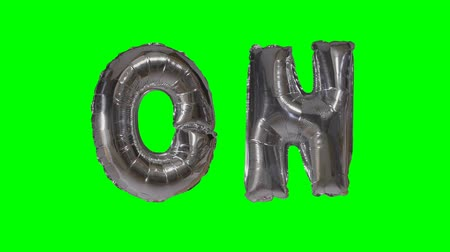kapcsoló : Word on from helium silver balloon letters floating on green screen