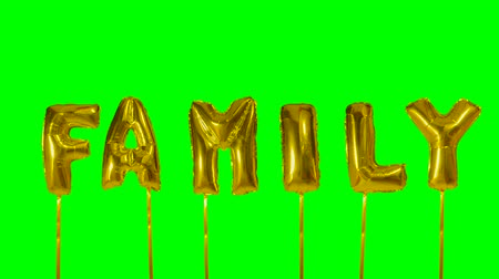 gonflable : Word family from helium golden balloon letters floating on green screen