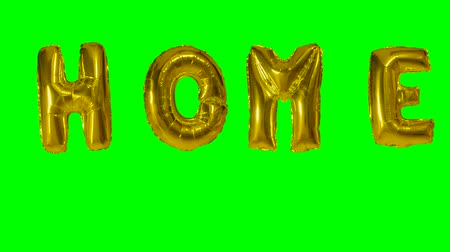глянцевый : Word home from helium gold balloon letters floating on green screen Стоковые видеозаписи