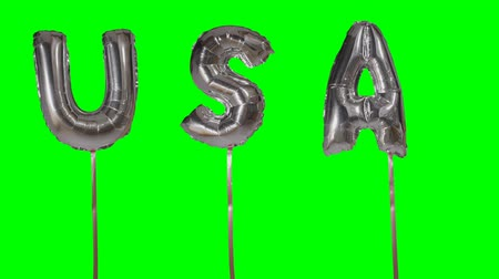 folyo : Word USA from helium silver balloon letters floating on green screen