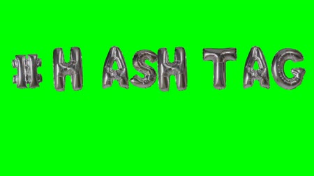 follower : Word hashtag from helium silver balloon letters floating on green screen