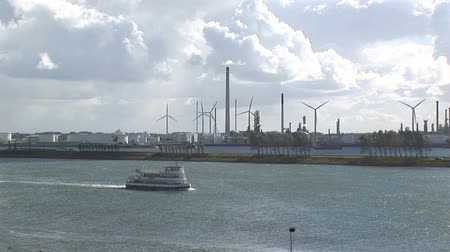 turbine : Wind turbines next to waterway