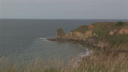 d day : Back zoom from cliffs on the English channel at Pointe du Hoc in Normandy France
