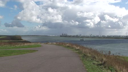 efektywność : Heavy clouds across the mouth of the Rotterdam waterway with wind turbine in distance, The Netherlands Wideo