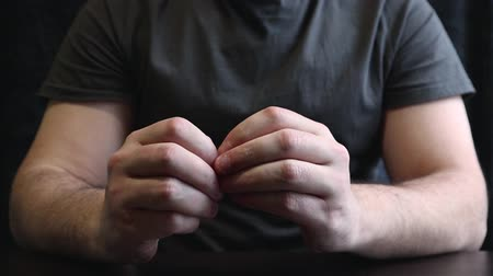 morder : Close view of male hands with strongly bitten nails. Finger selection with alarm. Ugly bitten fingers, cuticles, wounds on the fingers. Bad habit. The concept of onychophagy and dermatophagy. Stock Footage