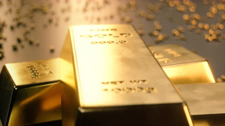 might : Fine Gold bars 1000 grams on the floor with scattered pieces of gold. Concept of wealth