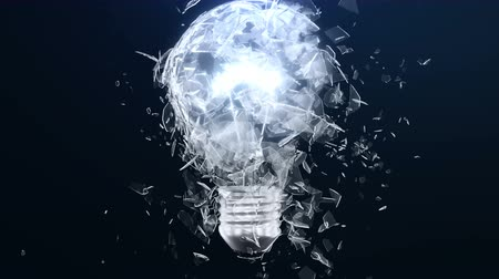 megolvad : Explosion of an incandescent lamp or ligh bulb. Small pieces of glass fly apart in different directions. The effect of slowing down the time after the explosion. Problem solving concept.