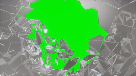 danger of collapse : Wall of glass with a hole in the center of shatters into small pieces. Place for your banner, advertisement. The explosion caused a crack in the wall, 4K 3D animation on a green background Stock Footage