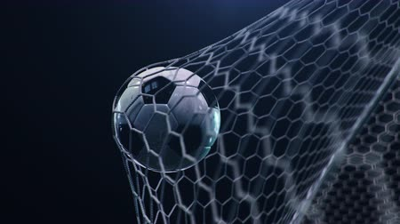 futball labda : Soccer ball flies beautifully into the goal in slow motion. Soccer ball flies into the goal bending the grid on flares background, ball rotating in slow motion. Moment delight football 3d 4k animation