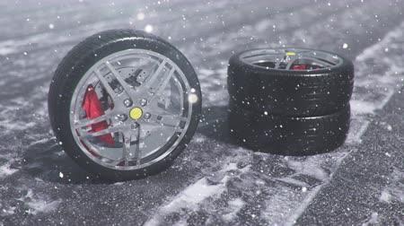 yedek : Winter tires on a background of snowstorm, snowfall and slippery winter road. Winter tires concept. Wheel replacement. Road safety concept. 4k 3d animation with falling snow