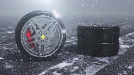 щит : Winter tires on a background of snowstorm, snowfall and slippery winter road. Winter tires concept. Wheel replacement. Road safety concept. 4k 3d animation with falling snow