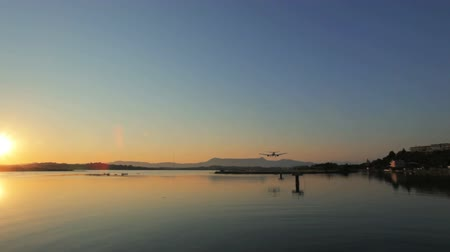 chegada : Landing of airplane, sunset scene, Corfu airport, Greece