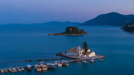 görögország : Time-lapse: aerial view of of Vlacherna monastery before sunset, Kanoni, Corfu, Greece