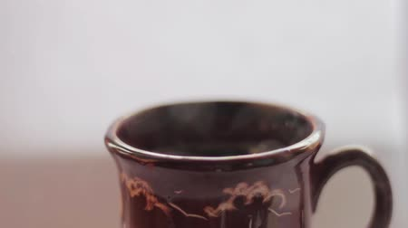 demlik : Pouring hot water into the mug, white background, close up, boiling water