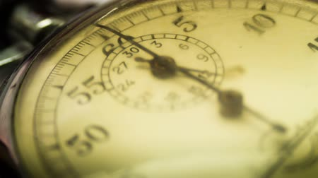 velocímetro : Close up of an antique stopwatch, clock, arrow, which moves in a circle of old clock face on a white background. Timelapse Stock Footage