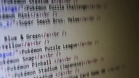 programmers : Computer html code with black letters on white background scrolling on a computer screen. Ideal for computer related projects, including coding, developing, programming, education, hacking, loading and data processing, among others. Stock Footage