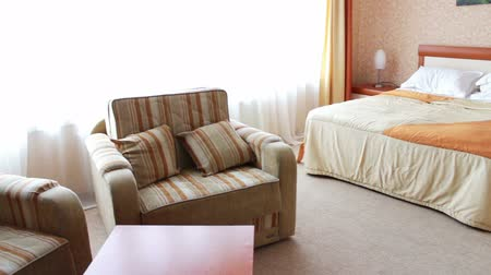 szállás : Sleeping double room at the hotel. The room has a big double bed, armchairs, paintings.