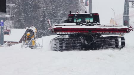snowcat : Snowcat with large caterpillars removes snow at the foot of the ski resort Bukovel. Stock Footage