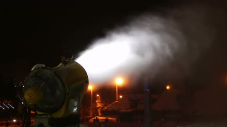 water cannon : Snow guns producing snow at night in the ski resort of Bukovel, Ukraine.