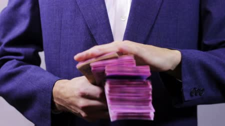 abundância : Businessman with Wads of Money in Hands.