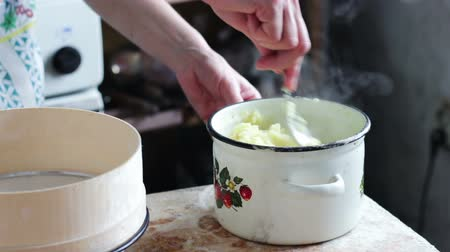 mashing : Woman Preparing Mashed Potatoes in the Home Kitchen