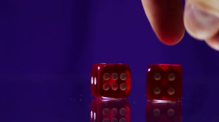 kazık : Playing red Casino Dice Cubes on a Glass Table. Stok Video