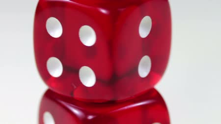 Ко : Dice Red Rotating on a White Background