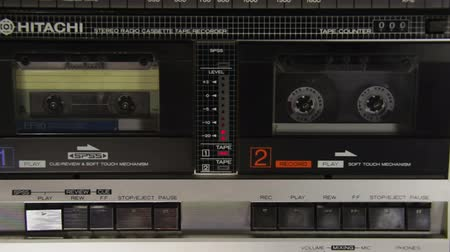 convés : Pushing a Finger Play and Stop Button on a Two Decks Tape Recorder