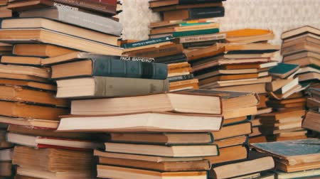 tome : Stack of Books Scattered on the Floor in the Library Stock Footage