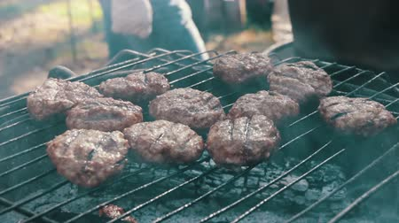 говядина : Meat for Burgers Prepared On The Grill Стоковые видеозаписи