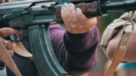 amendment : Woman Holds in Hands Machine Gun
