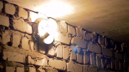 emitter : Filament Bulb Lights Up on a Stone Wall