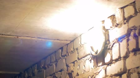 infra : Filament Bulb Lights Up on a Stone Wall