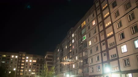 comutar : Multistorey Building With Changing Window Lighting At Night