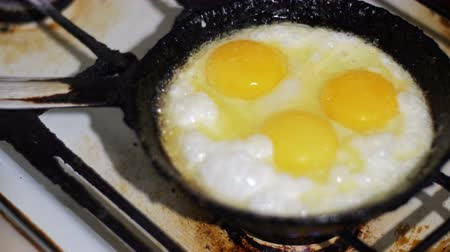 frypan : Fried Eggs Prepared on a Frying Pan Stock Footage
