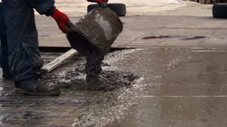 интерьер : Pouring, Laying Concrete at the Construction Site using Buckets of Cement. Стоковые видеозаписи