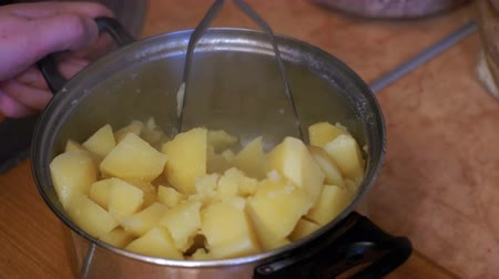 mashing : Mashing Potatoes in a Pan on the Home Kitchen Stock Footage