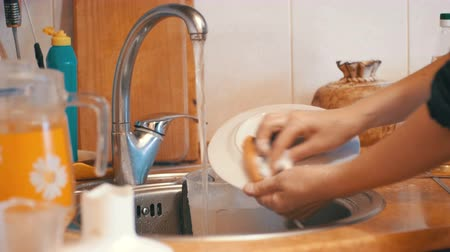 dish : Woman Washing Dishes in the Home Kitchen Stock Footage
