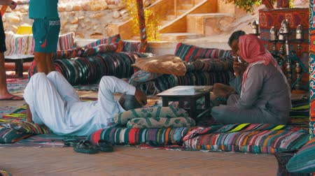 khalili : Bedouins and Arabs are Drinking Tea at Table in Egypt Stock Footage