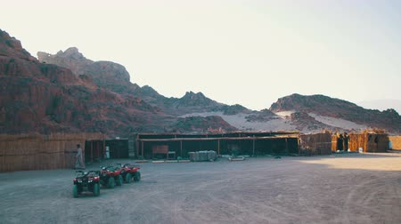 quads : Tourist Quads Bike for a Safari Excursion in the Desert of Egypt and Bedouin Settlements