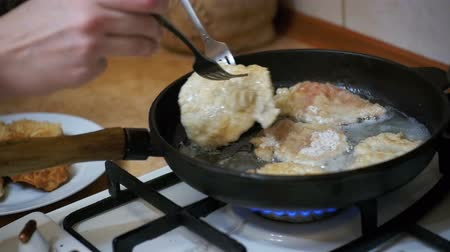 chop up : Cooking Meat Chops in a Frying Pan in the Home Kitchen. Slow Motion Stock Footage
