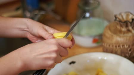 peeler : Peeling Potatoes in the Home Kitchen. Slow Motion