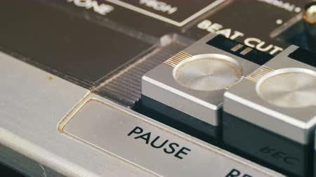 casette : Pushing Pause Button on a Vintage Tape Recorder