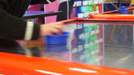 hurl : Children Play in the Air Hockey Game in the Childrens Entertainment Center Stock Footage