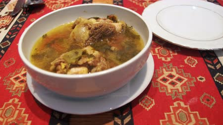 beef soup : Mutton soup in the Restaurant. Soup of Piti, Azerbaijan National Dish