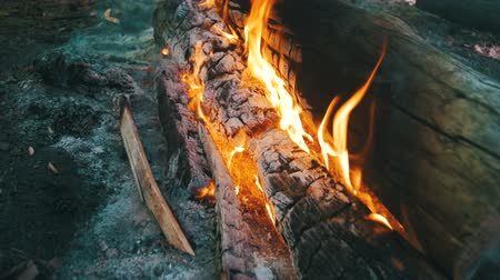 ruinous : Background of a Fire, a Log Burns. Dolly Shot. Slow Motion Stock Footage