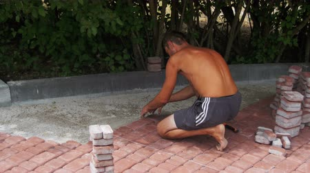 paving : Worker is Laying Paving Stones using Hammer Stock Footage