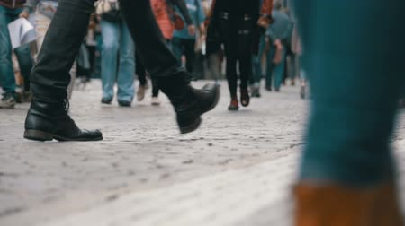 europe population : Feet of Crowd People Walking on the Street in Slow Motion