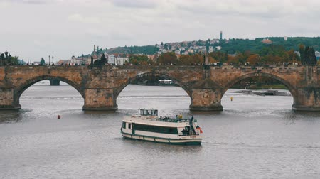 charles bridge : Landscape view of Prague Bridge and Water Bus Boat Floating on the River Vltava