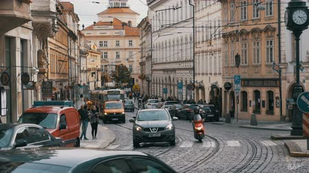 daily : Car Traffic and Czech Tram Rides through the Old City of the Czech Republic, Prague. Slow Motion